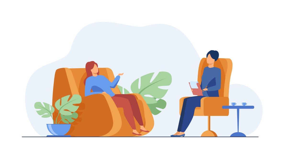 rozmowa między dwoma kobietami. jedna siedzi na fotelu a druga na kozetce